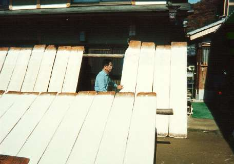 Mr Fukunishi checks on the paper drying in the sun